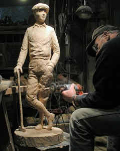 Jerry ward working on sculpture of golfer